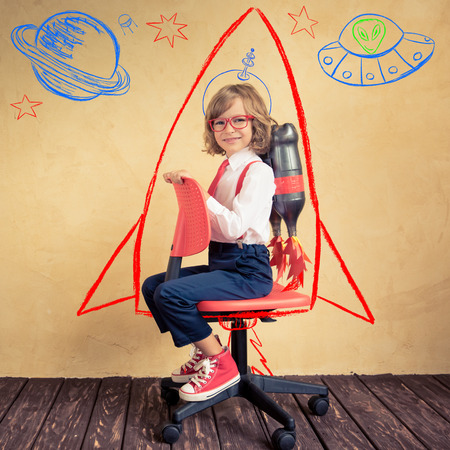46594525 - portrait of young businessman with jet pack riding office chair. success, creative and innovation technology concept. copy space for your text